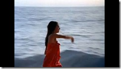 Elizabeth Logue running down the beach