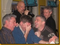 I'm absolutely convinced that they're laughing at me. These guys are in Provincetown and are probably in a gay bar, and they're still having a manlier time than I was.